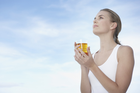 woman-drinking-glass-of-apple-juice-/ PHOTO FROM http://www.dailyrecord.co.uk