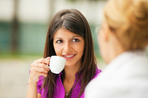 woman-having-coffee-with-friend / photo from http://www.sheknows.com