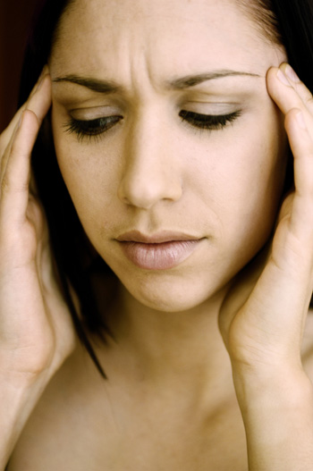 woman-with-headache / photo from http://www.sheknows.com